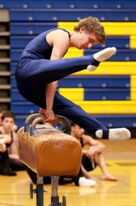 The boys' gymnastics team practices. Photo by Kelsey Stevens.