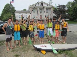 Participants of the Chinese exchange program and their chaperones show their excitement for paddle-boarding. (Photo courtesy of Andover Youth Services)