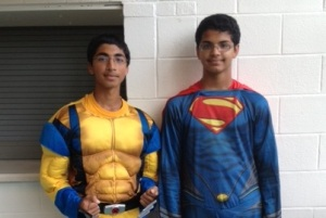 Vibhav and Shishir Bhat go to school as superheroes prior to the marching band's performance. (Photo by Alison Murtagh)