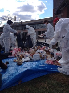 Students donned protective suits and masks to participate in the waste audit. (Photo by John Barry)