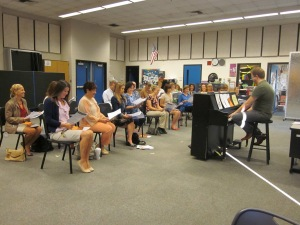 Mr. Mercer (right) leads fellow faculty members in attendance at a recent choir rehearsal. (Photo by Tarushi Sharma)