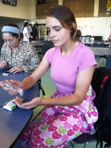 Sophie Draper, senior, attempts to stay healthy with her hand sanitizer and tissues. (Photo by Devon Heavey)