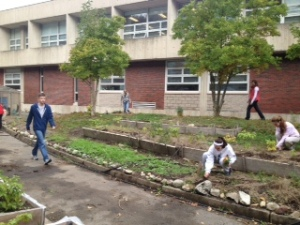 Students toil in the sustainable garden, but fewer are doing so since the decrease in Environmental Science classes. (Photo by Marisa Dellatto)