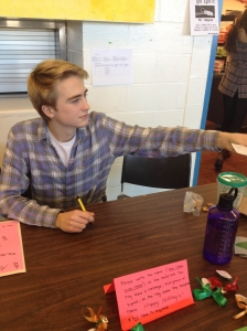 Senior Board member Max Galat sells tickets for the Holly Ball during lunch.