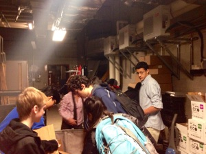 Environmental Club members help empty container full of donated electronics. (Photo by Tarushi Sharma)