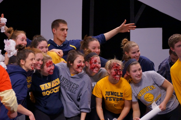 The girls and boys basketball players pose for a photo after a great pie-eating contest.