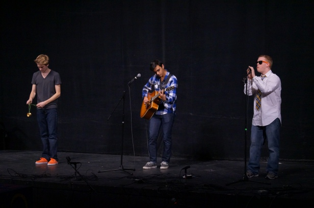 Max, Tommy, and Huzefa all sing, play the guitar and yo-yo in their performance together.