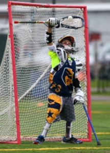 Kane Goodman plays goalie for Andover's fifth-grade B team despite cancer that limits his mobility. (Courtesy Photo)