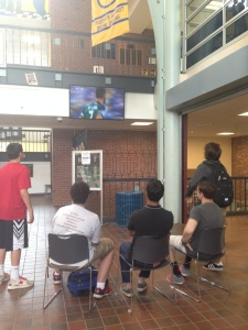 Students take a break from classes to catch a few minutes of the World Cup in the lobby last Friday afternoon. (Photo by Delianna Marmolejos)