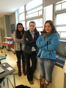 Juniors Rhea Singh, Mackenzie Kennedy, and Anna Mankovich (left to right) miserably stand next to cool blowing vents. (Photo Illustration by Elena Primes)