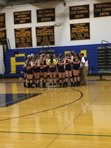 The AHS Lady Warriors huddle together during a time-out. (Photo by Elena Primes)