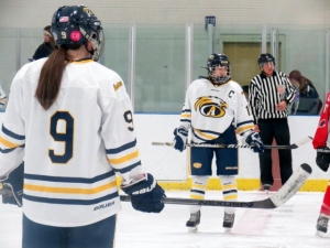Jess Leone, right, prepares for the puck drop at the Jan. 10 home game against Central Catholic. (Photo by Alexandra Scott)