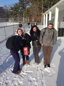 Students (from left, Jennifer Marble, Katie McDermont, Elena Connors, and John Molloy) huddle from the cold during their walk from Red Spring. (Photo by Dillon Clancy)