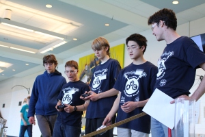 Andover Robotics Club members Dan Combs, Sebastian Harder, Luke Nawrocki, Chris Zhao and Julian Amirault (from left to right) work on their robots enjoy downtime at the competition. (Photo by Elena Primes)
