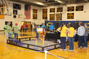 Teams surround the FTC field in the Dunn Gym in preparation for a match. (Photo by Elena Primes)