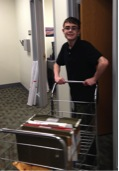 AHS student Kyle Cianciulli delivers mail at Pfizer as part of the Learning to Work Program. (Courtesy Photo)