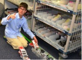 AHS student Will Rullo takes inventory as part of his work at Pfizer. (Courtesy Photo)